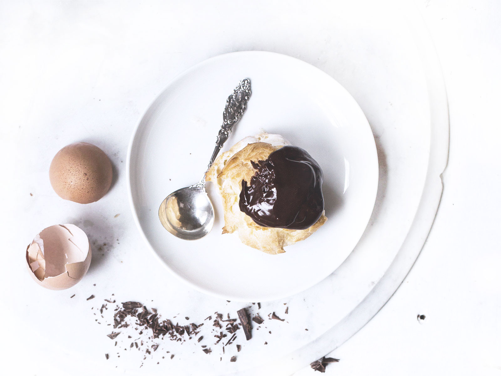 Chocolate profiteroles with vanilla sauce and chocolate slices