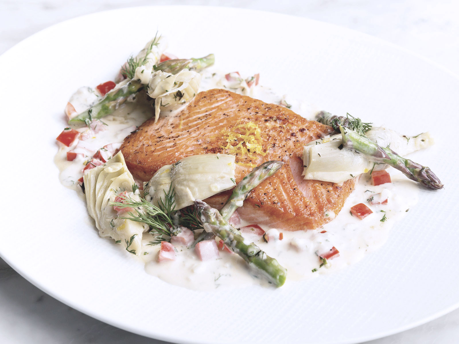 Salmon with celery sauce and spring asparagus
